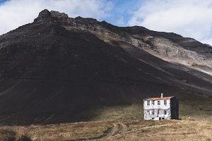 Abandoned House and Mountain Range