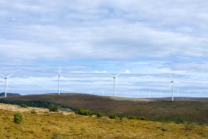 Wind turbines in mountain scenery.