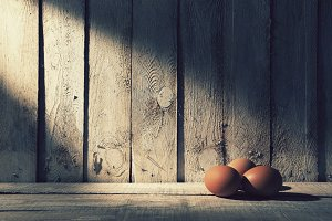Fresh eggs with rustic wood wall