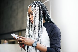 African woman using smartphone