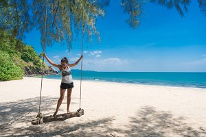 Girl on a bamboo swing in Paradise