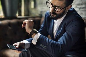 Classy man looking a watch