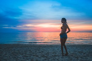 Girl on a beach at sunset