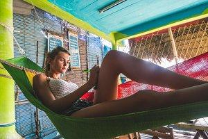 Girl lying in a rasta hammock
