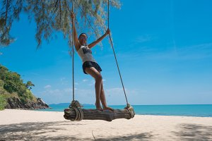 Girl on a swing in paradise 2
