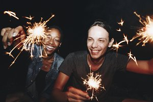 Friends celebrating with sparklers