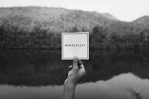 Wanderlust text in nature travel