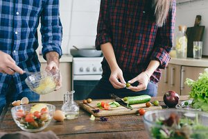 Couple preparing summer salad