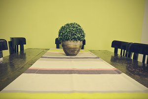 Dining table with vase and table runner