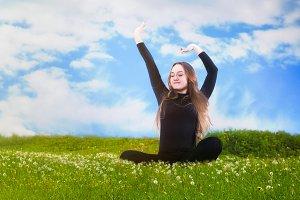 Happy girl. Green grass, blue sky. Concept-ease, health, outdoor recreation