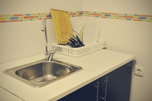 Sink and scrubbed dishes in the kitchen