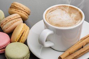 Cappuccino, macaroons, cinnamon.