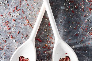 Spoons with heart-shaped holes on a