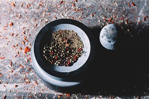 Mixed colorful grains of pepper in a