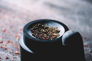 Half-crushed dried peppercorns place