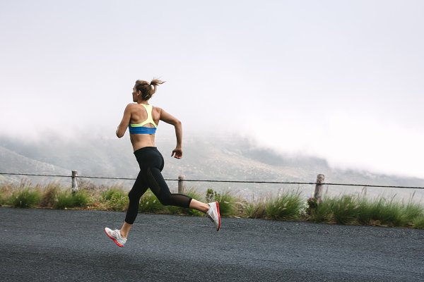 Sports Stock Photos: Jacob Lund Photography - Woman athletes running on road