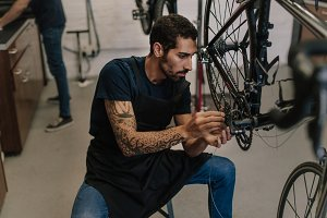 Mechanic repairing a bicycle