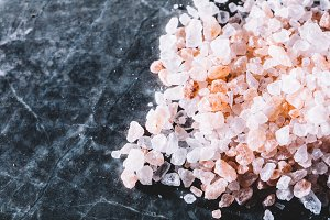 Grains of Himalayan salt on marble b