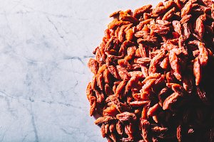 Little red dried goji berries on a p