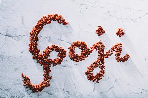"""Goji"" word composed of little red g"
