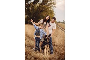 portrait of a young family and their dogs outdoors