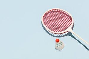 Oldschool racket and birdie on blue