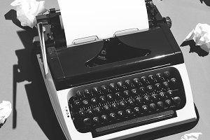 Oldschool typewriter and creased pap