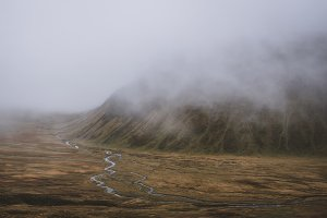 Moody Mountain Landscape with Fog