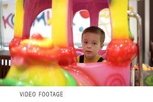 Boy in amusement train