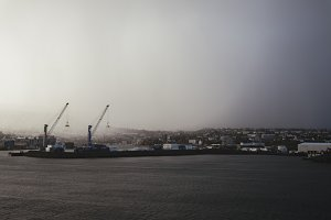 Harbor Cranes with Snow Clouds