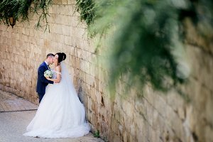 Bride and groom kiss each others