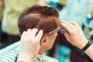Men's beauty salon. Haircut closeup.