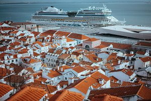 Rooftopspanorama of the oldest district Alfama in Lisbon. Cruise boat AIDA on the Tagus River. Lisbon Lisboa Lissabon