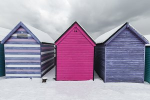 Beach huts winter snow