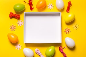 Empty box and Easter decor on yellow