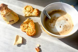 cappuccino and crumbled biscuits
