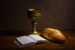 Chalice, bread and Holy Bible