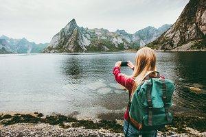 Girl tourist taking photo