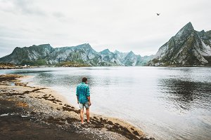 Man walking alone at fjord in Norway