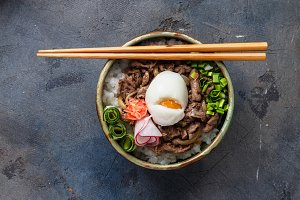 Top view beef bowl gyudon with rice and egg