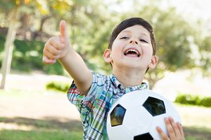 Young Boy Playing with Soccer Ball