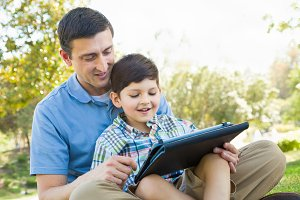 Father, Son Using Computer Tablet