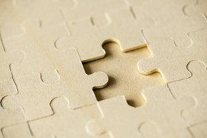 Macro shot jigsaw puzzle missing
