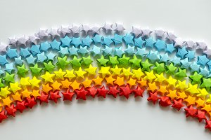Colorful origami stars forming