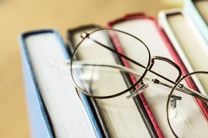 A pair of glasses and books