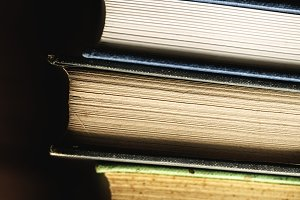 Closeup of stack of antique books