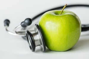 Closeup of apple and a stethoscope
