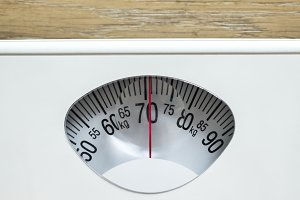 Closeup of weight scales overweight
