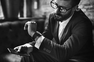 A businessman looking a watch