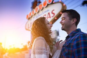 romantic couple by vegas sign